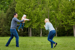 Family playing in the park. royalty free stock image