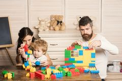 Family playing with plastic blocks. Family and childhood concept. stock photography