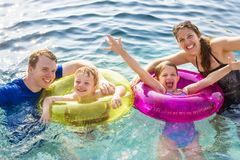 Family playing in a pool royalty free stock images