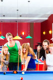 Family playing pool billiard game Royalty Free Stock Photography