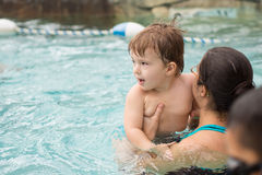 Family playing in the pool. At Jay Peak's water park and resort Royalty Free Stock Photo