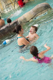Family playing in the pool. At Jay Peak's water park and resort Royalty Free Stock Photos