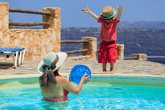Family playing at the pool. Mother and son playing at the pool Royalty Free Stock Images