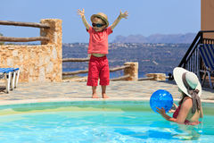 Family playing at the pool. Mother and son playing at the pool Royalty Free Stock Photo