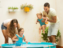 Family playing in pool at terrace Stock Photography