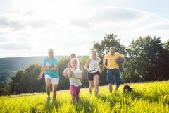 Family playing, running and doing sport in summer. Landscape Stock Photo