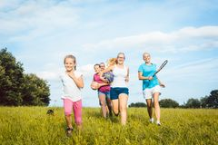 Family playing, running and doing sport in summer stock photo