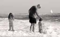 Family Playing at Seashore Royalty Free Stock Photo