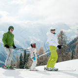 Family playing on ski Royalty Free Stock Photos
