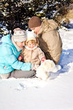 Family playing in snow Stock Image