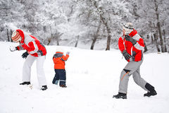 Family playing with snow Royalty Free Stock Photography