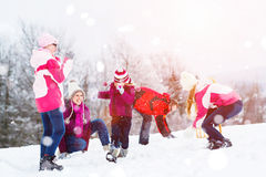 Family playing in snow having fight with snowballs Stock Photography