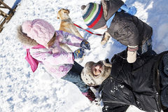 Family playing in snow. Stock Photo