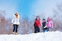 Family playing snowball Stock Photography