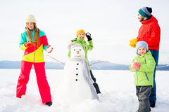 Family playing snowballs Royalty Free Stock Images