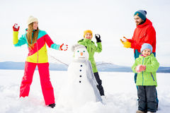 Family playing snowballs Royalty Free Stock Photography