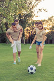 Family playing soccer Stock Photos