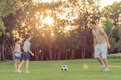 Family playing soccer Stock Images