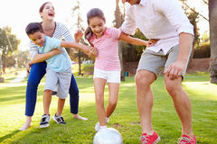 Family Playing Soccer In Park Together Royalty Free Stock Photography