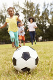 Family Playing Soccer In Park Together Stock Photography