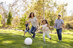 Family Playing Soccer In Park Together Royalty Free Stock Photos