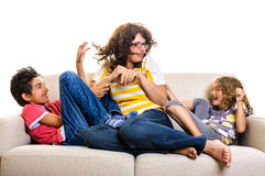 Family playing on sofa Royalty Free Stock Photography