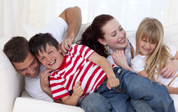 Family playing on sofa together Royalty Free Stock Photo