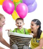 Family playing with son in flight on a makeshift Stock Image