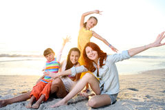 Family playing at the sunny beach. Royalty Free Stock Photo