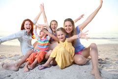 Family playing at the sunny beach. Royalty Free Stock Image
