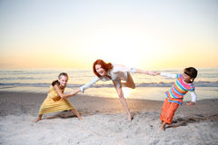 Family playing at the sunny beach. Royalty Free Stock Photography