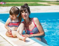 Family playing in swimming pool. Stock Photo