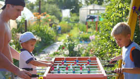 Family playing table football outdoors.Fun outdoors Royalty Free Stock Photography