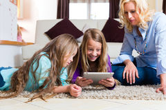Family playing with Tablet computer at home Stock Photos
