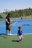 Family playing tennis. Child at tennis court Stock Photo