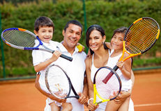 Family playing tennis Royalty Free Stock Images