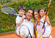 Family playing tennis Stock Image