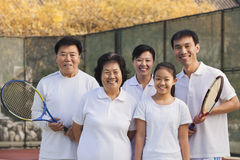Family playing tennis, portrait royalty free stock images