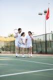 Family playing tennis, portrait stock photos