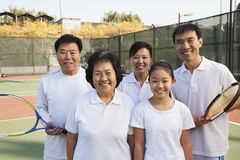 Family playing tennis, portrait Stock Images