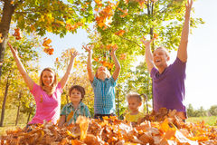 Family playing and throwing leaves in the air stock images