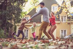Family playing together outside. On the move. royalty free stock photo