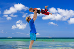 Family playing on tropical beach Stock Photography
