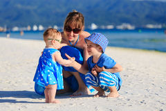 Family playing on tropical beach Royalty Free Stock Images