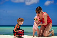 Family playing on tropical beach Stock Images