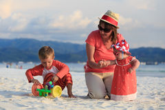 Family playing on tropical beach Royalty Free Stock Photo
