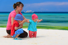 Family playing on tropical beach Stock Photos