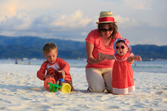 Family playing on tropical beach Royalty Free Stock Photos