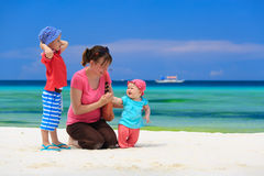 Family playing on tropical beach Stock Photo
