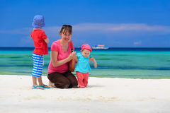 Family playing on tropical beach Stock Image